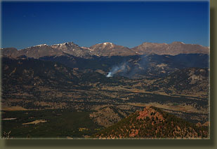 Small fire sends up smoke to the northwest of Estes Cone
