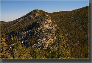 high point of the Poudre Wilderness and the rocky scramble down the southwest side